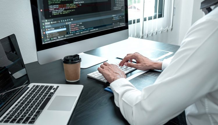 young-programmer-working-software-javascript-computer-it-office-min